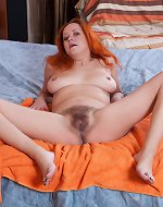 Natali masturbates with a toy in her bedroom